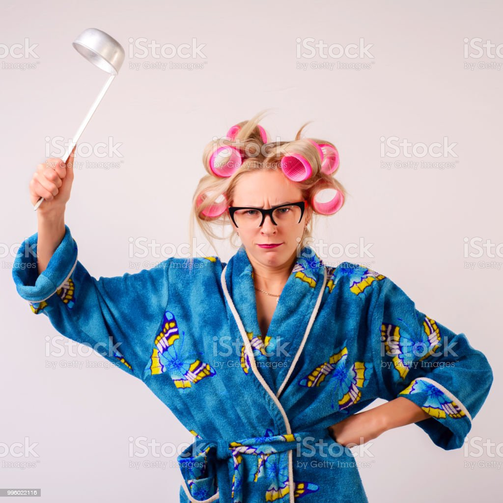 A Harsh Woman In A Dressinggown And Curlers Swings A Ladle Stock ...
