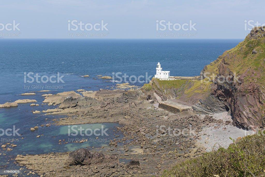 Hartland Point lighthouse Devon England with blue sea stock photo