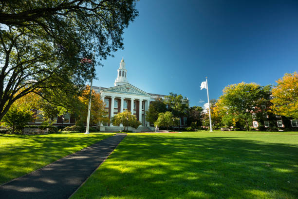 Harvard Business School in Boston Massachusetts USA Boston, Massachusetts, USA - October 18, 2018:  Harvard Business school building in Cambridge Massachusetts USA.  Harvard Business School (HBS) is the graduate business school of Harvard University in Boston, Massachusetts, United States. The school offers a large full-time MBA program, doctoral programs, HBX and many executive education programs. It owns Harvard Business Publishing, which publishes business books, leadership articles, online management tools for corporate learning, case studies and the monthly Harvard Business Review. harvard university stock pictures, royalty-free photos & images
