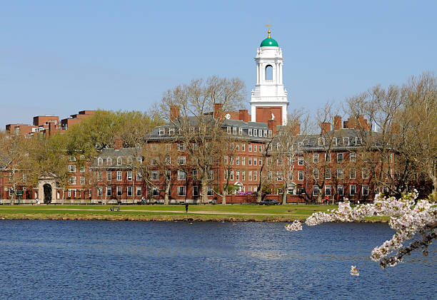 Harvard in the spring Harvard University Eliot House across Charles River, in Cambridge, Massachusetts harvard university stock pictures, royalty-free photos & images