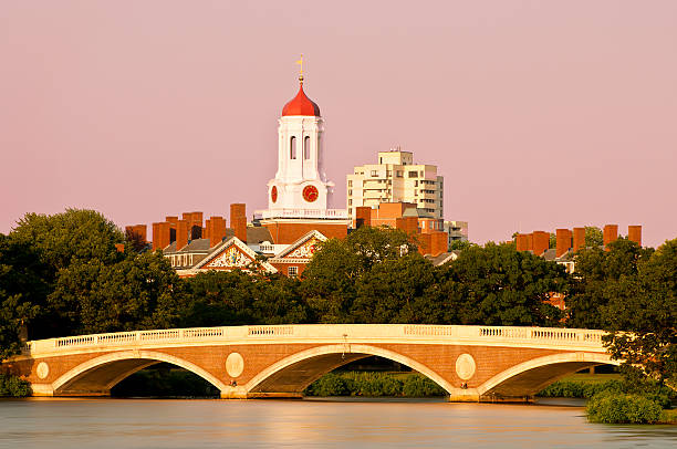 Harvard Sunset view of Harvard University and Weeks Bridge footbridge stock pictures, royalty-free photos & images