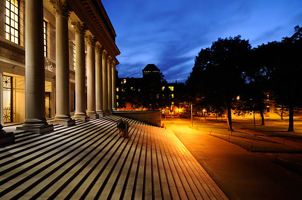 Harvard University at Night Harvard University library and campus at night. Success in education and tourist attraction in Cambridge, Massachusetts. harvard university stock pictures, royalty-free photos & images