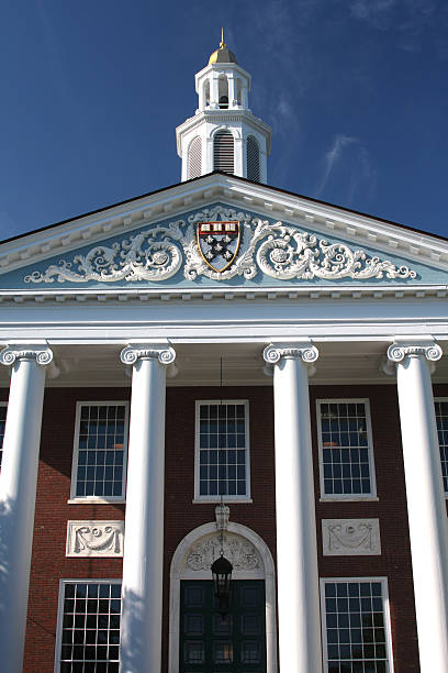Harvard University Harvard University is a university in Cambridge, Massachusetts, and a member of the Ivy League. Harvard is the oldest institution of higher learning in the United States. harvard university stock pictures, royalty-free photos & images
