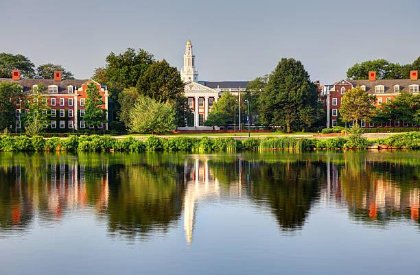 Harvard University Boston, Massachusetts, USA - July 5, 2015: Harvard University campus reflecting on the Charles River at dawn.  harvard university stock pictures, royalty-free photos & images