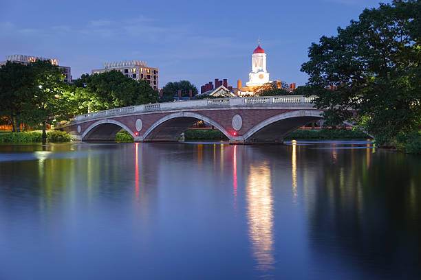 harvard university reflecting on the charles river - harvard university stock photos and pictures