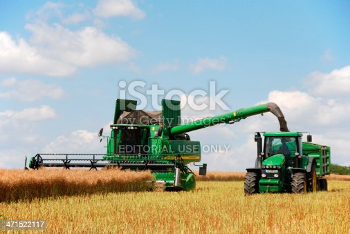 Weimarer Land, Germany - July 8, 2007: Harvest - John Deere 9880i STS Combine on duty at canola field.
