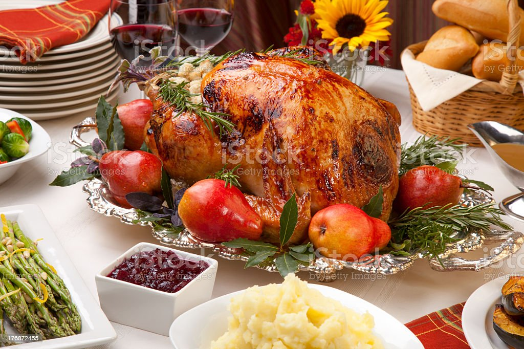 Harvest feast with roasted turkey royalty-free stock photo