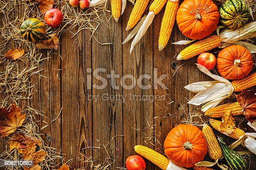 Harvest or Thanksgiving background with autumn vegetables and gourds on a rustic wooden table