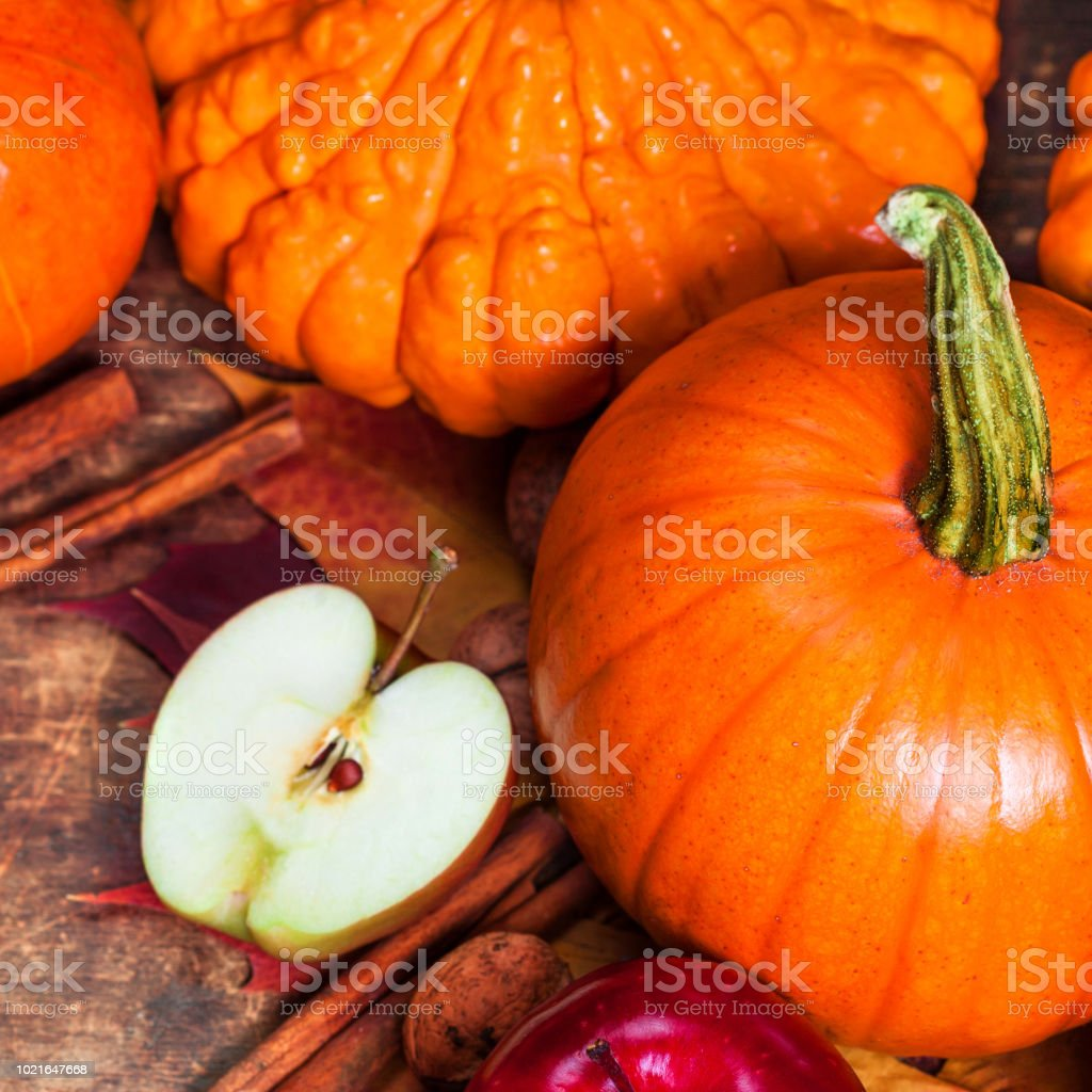 Harvest or Thanksgiving background with pumpkins, apples and fallen leaves on wooden background  with copyspace. Halloween, Thanksgiving day or seasonal autumnal concept'n stock photo