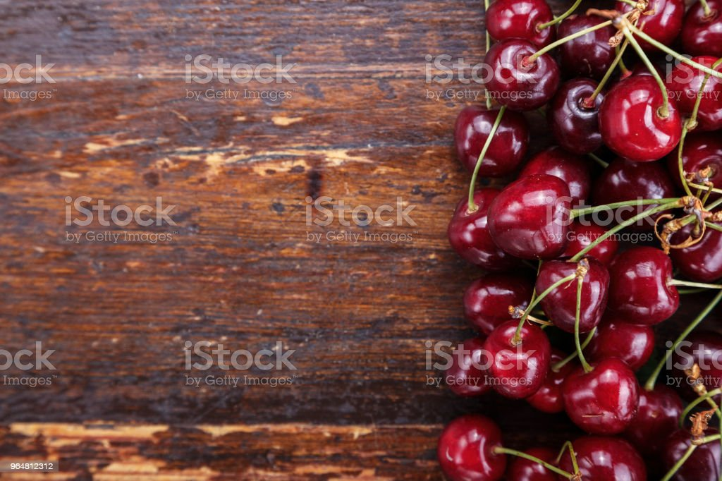 harvest ripe cherries, many berries are scattered as a background royalty-free stock photo