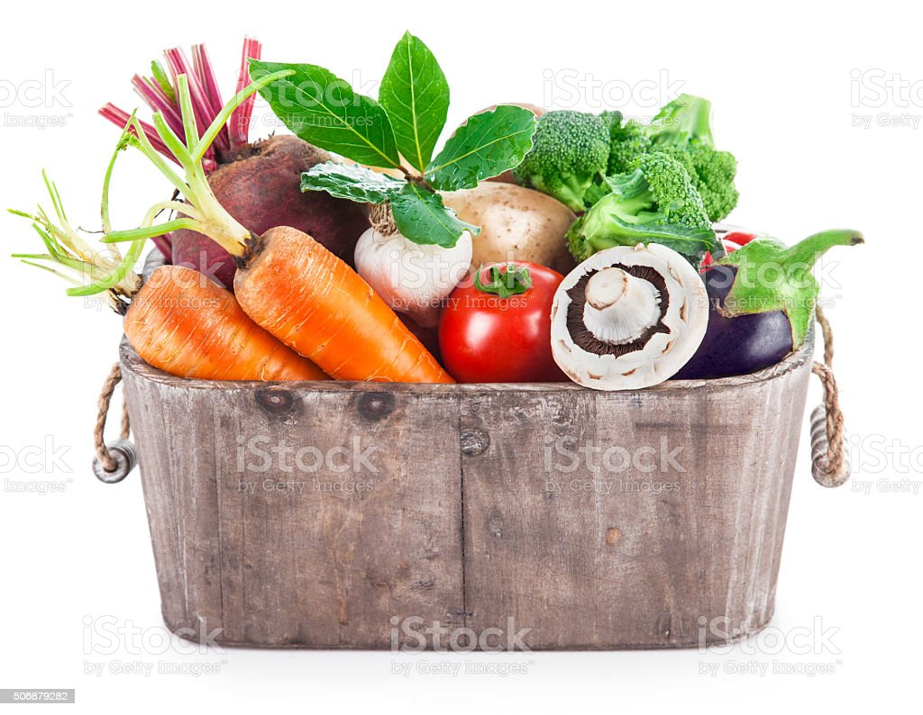 Harvest vegetables in wooden basket stock photo