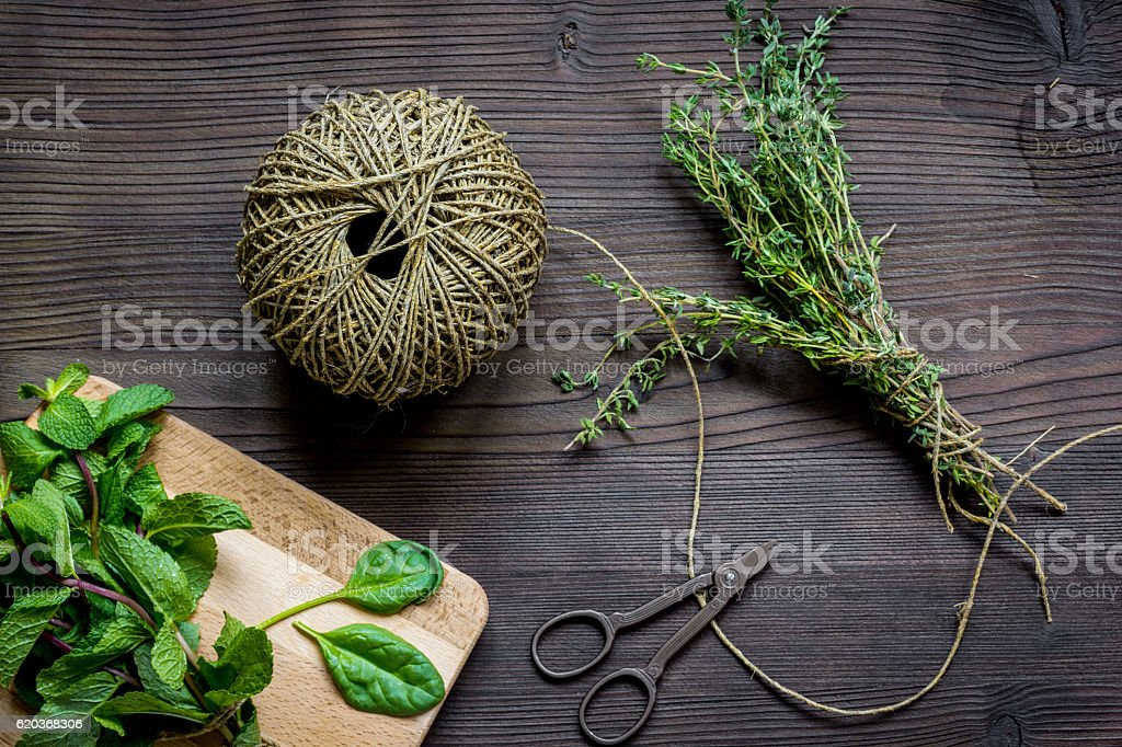 harvesting herbs for winter top view on wooden background zbiór zdjęć royalty-free