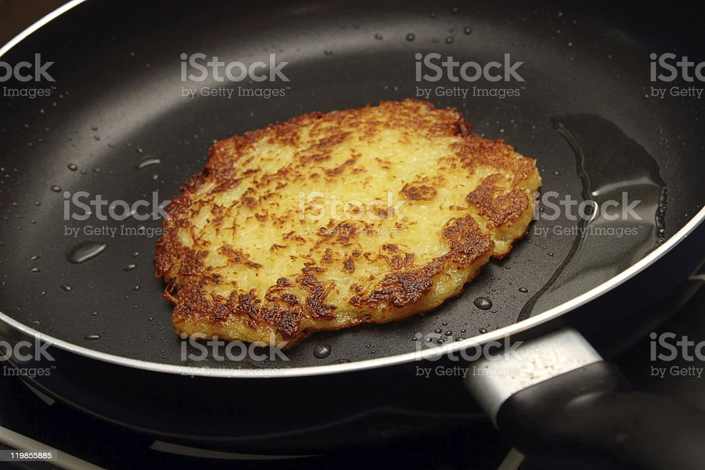 hash browns in a pan stock photo