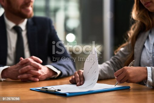 istock Hashing out the terms and conditions of the contract 912978286