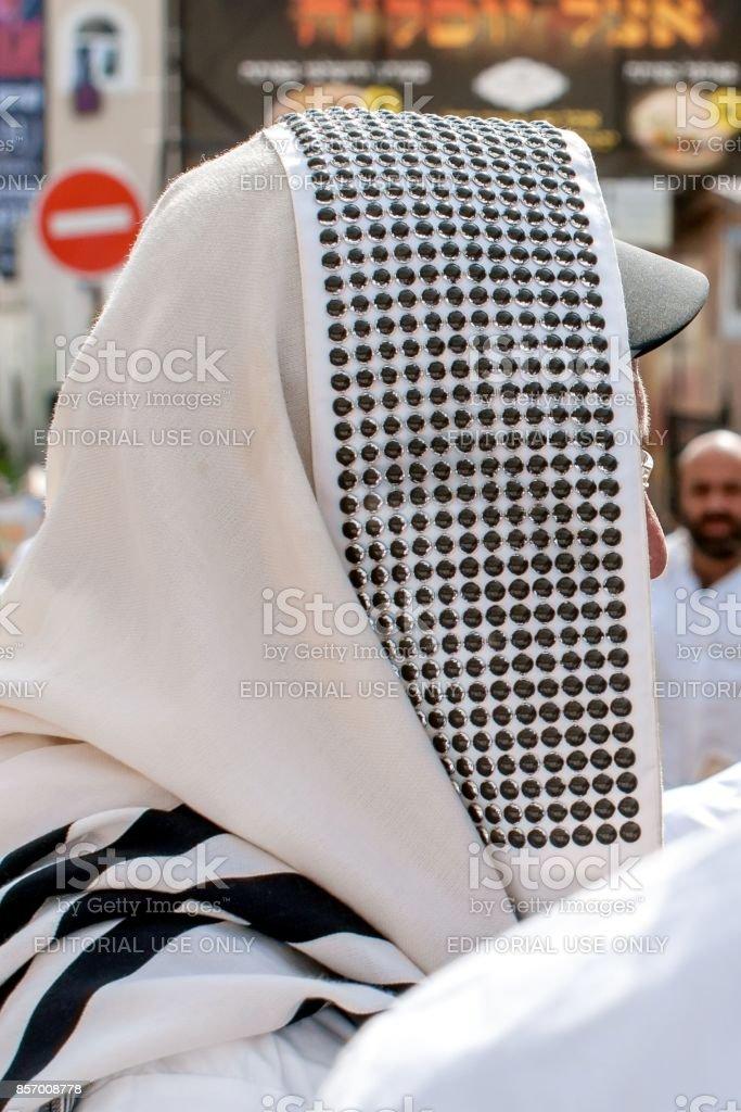 Hasid pilgrim in traditional clothes. Tallith - jewish prayer shawl. stock photo
