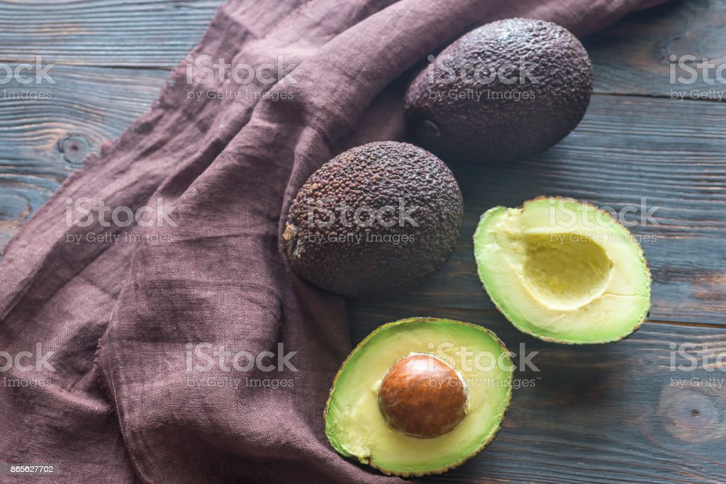 Hass avocados on the wooden background stock photo