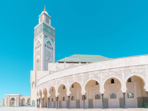 Hassan II Mosque in Casablanca on the blue cloudless sky background. stock photo