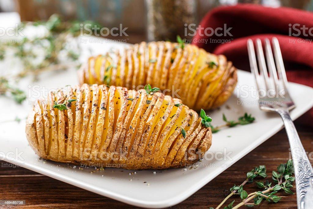 Hasselback potatoes stock photo