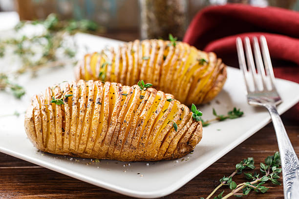 Hasselback potatoes stock photo