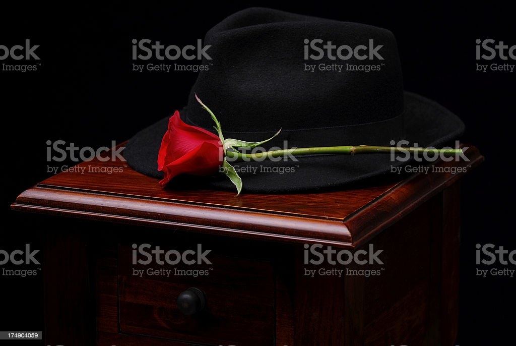 Hat and Flower on Nightstand royalty-free stock photo
