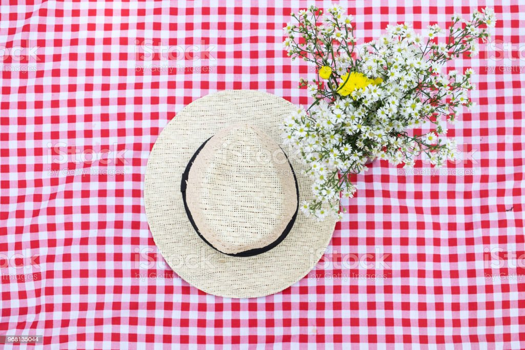 Hat And Flower On The Red Classic Checkered Tablecloth Background Use For  Background With Copy Space Stock Photo   Download Image Now