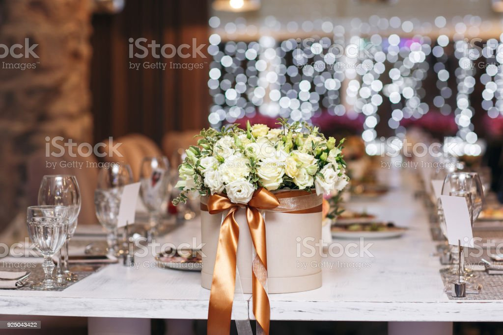 hat box with flowers close-up. Wedding. Banquet. The chairs and table...