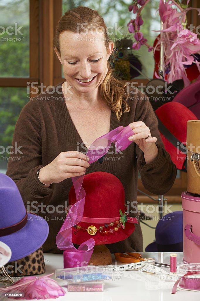 Hat Designer Working In Studio stock photo