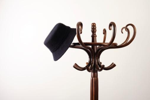 hat hanging on a coat rack