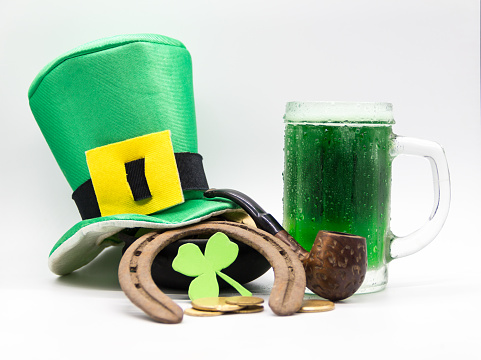 hat, horseshoe, clover, coins, green beer, saint patrick's day symbols on white background