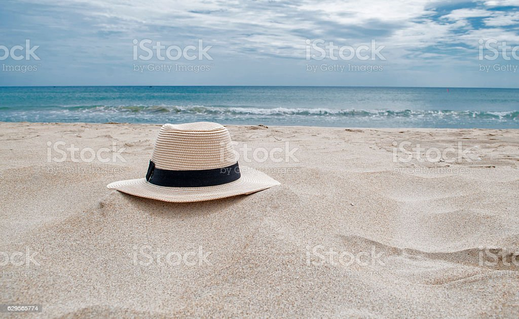 hat in the beach stock photo