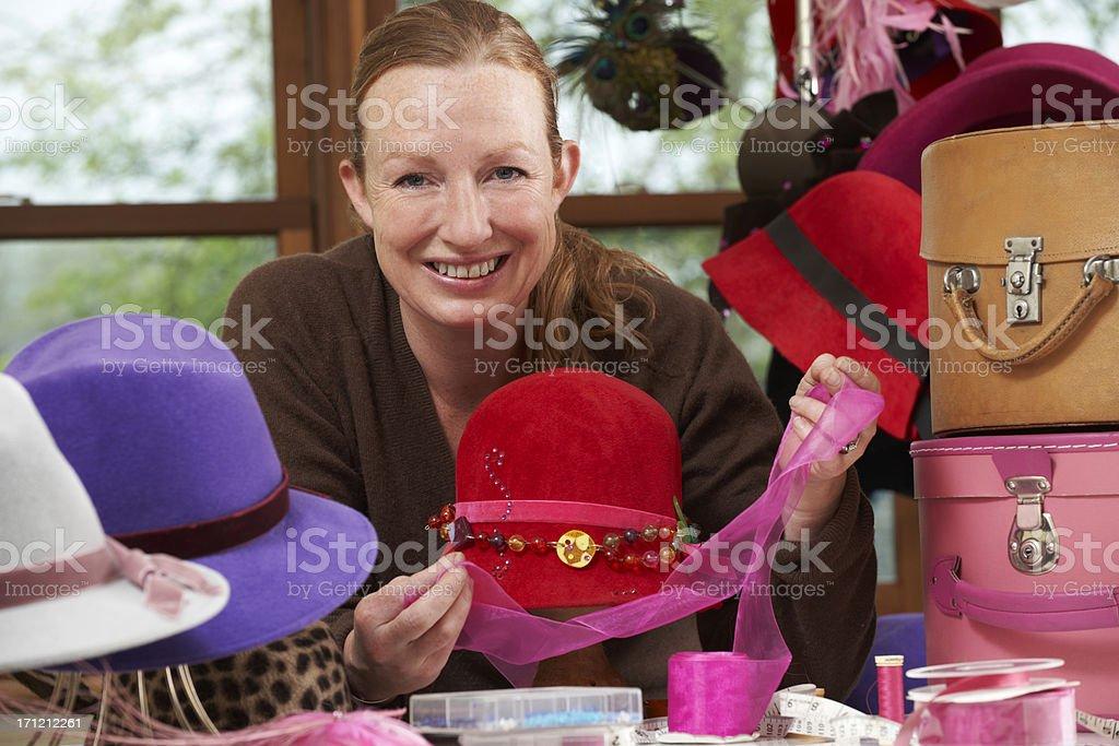 Hat Maker Working On Design In Studio stock photo