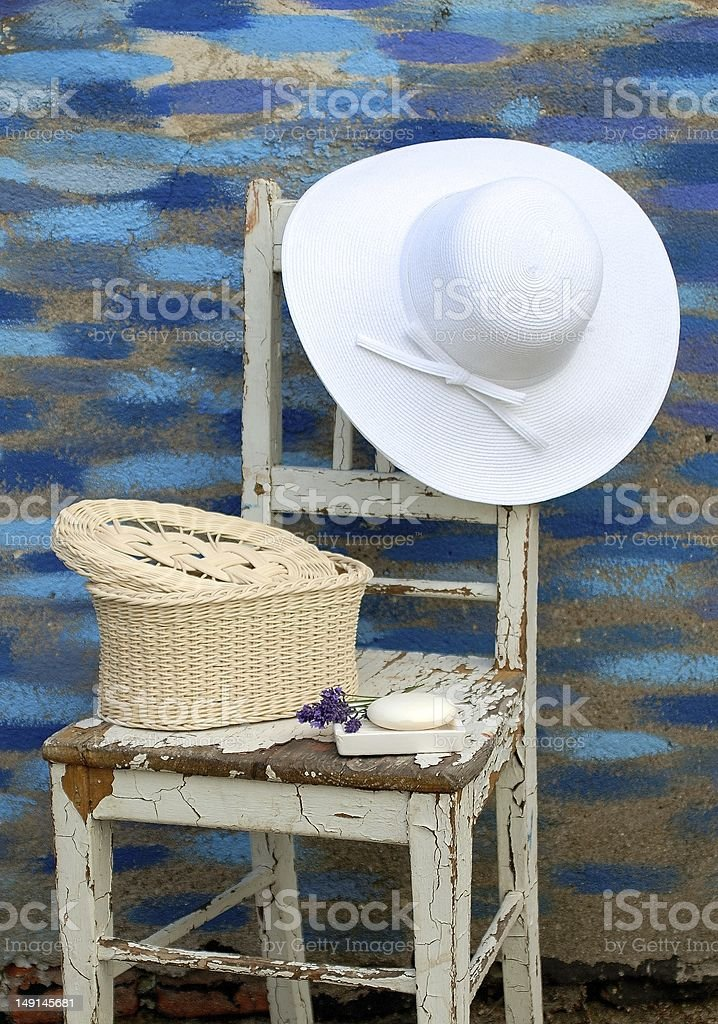 hat on a chair, basket and soap stock photo