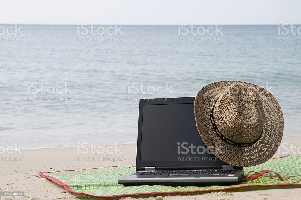 Hat on the laptop stock photo