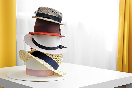 hat stack on white table in the room with copy space