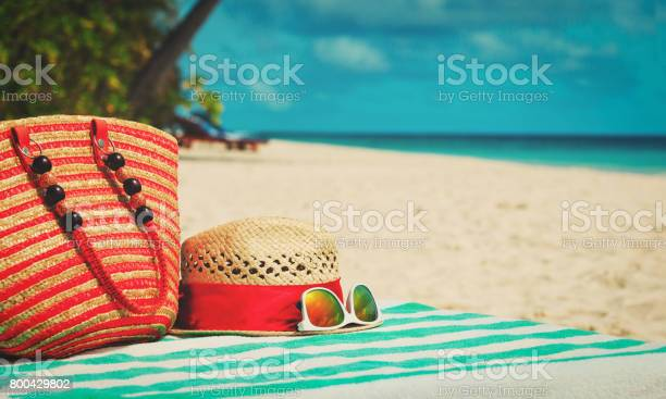 hat, sunglasses and bag on beach