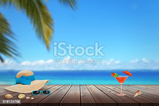 674650538istockphoto Hat, sunglasses, cocktail, shell on beach table. Free 518124796