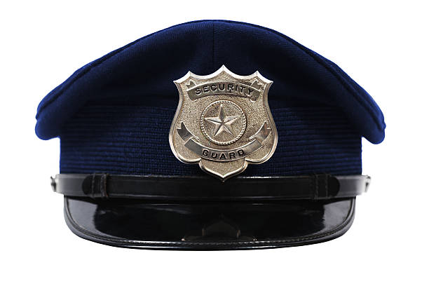 Hat with security guard badge Generic security Guard badge on a blue hat. uniform cap stock pictures, royalty-free photos & images