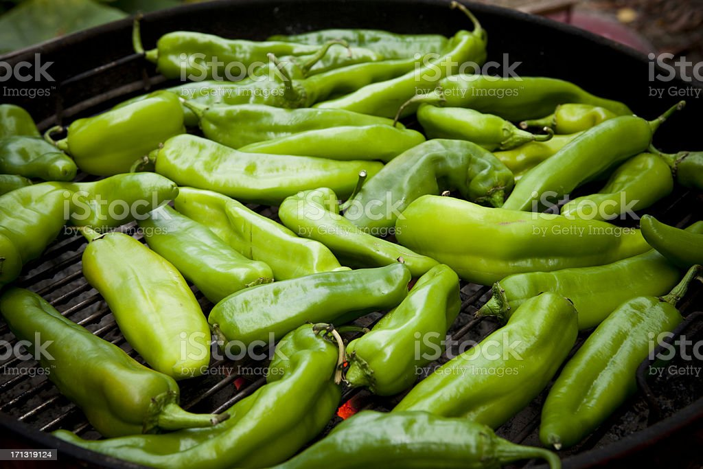 Hatch Chiles roasting over a fire stock photo