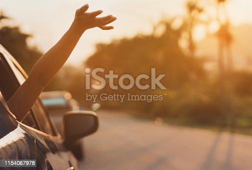 832085296 istock photo Hatchback Car travel driving road trip of woman summer vacation in blue car at sunset,Girls happy traveling enjoy holidays and relaxation with friends together get the atmosphere and go to destination 1154067978