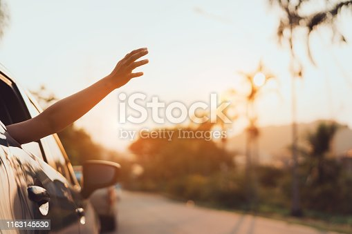832085296 istock photo Hatchback Car travel driving road trip of woman summer vacation in blue car at sunset,Girls happy traveling enjoy holidays and relaxation with friends together get the atmosphere and go to destination 1163145530
