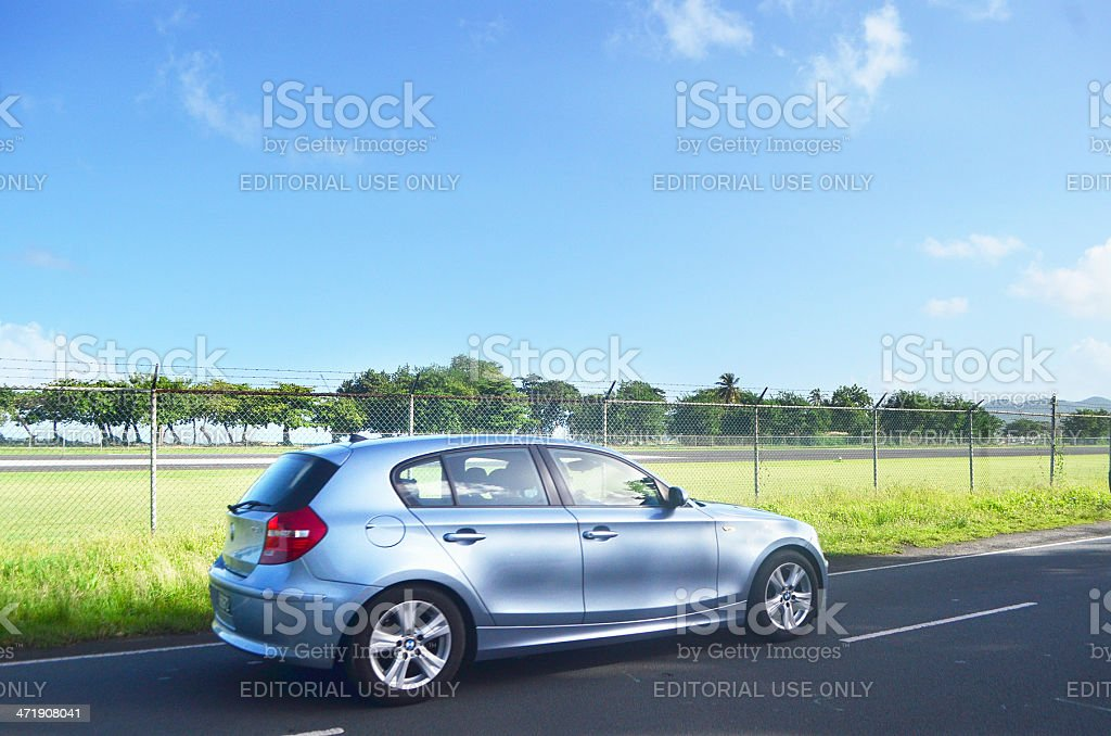 BMW hatchback driving down highway royalty-free stock photo