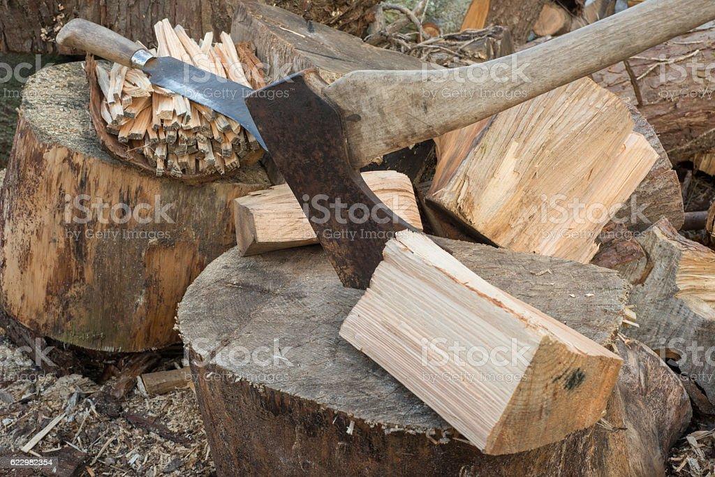 Hatchet by Chunks of Firewood stock photo