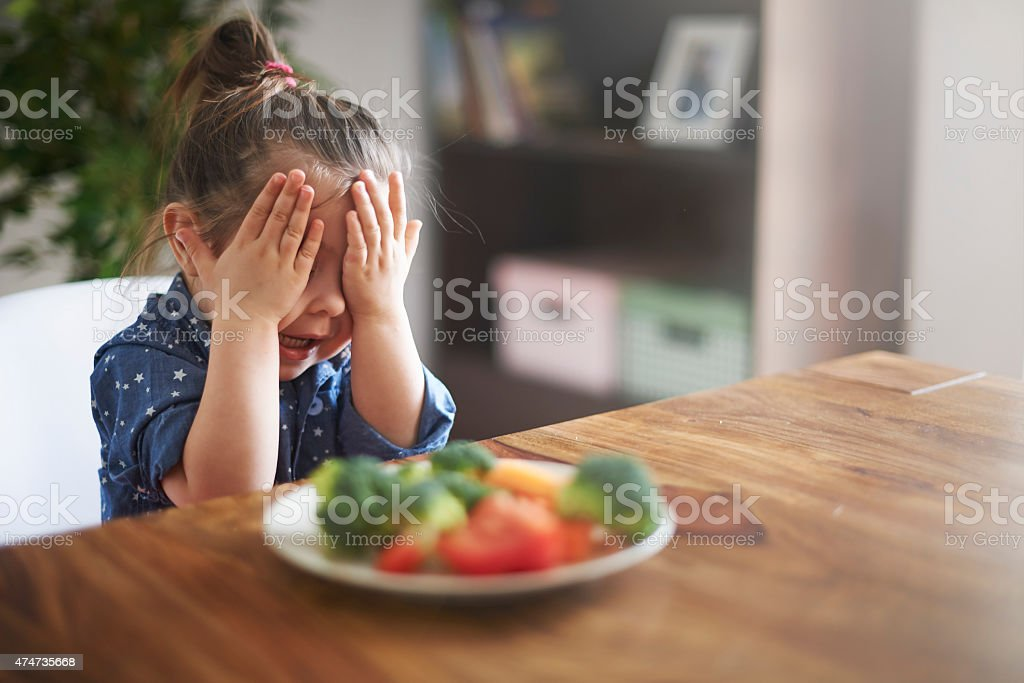 I hate a vegetables! I'm not eating this! stock photo
