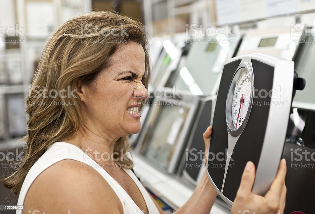 I hate bathroom scales royalty-free stock photo