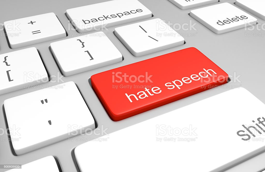 Hate speech key on computer keyboard representing online defamatory comments stock photo