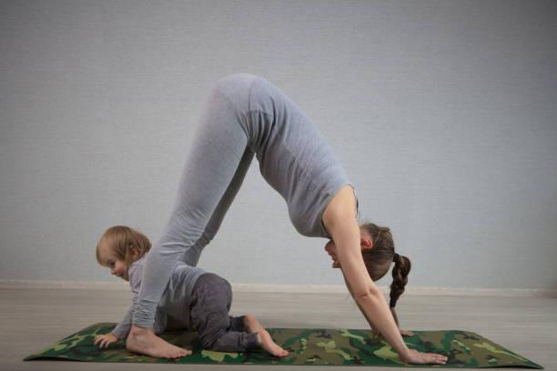 Hatha yoga fitness mother with baby picture id826806510?b=1&k=6&m=826806510&s=612x612&w=0&h=hlpkukiputsjdo jq3pzuldxz0w kjtsbo0wjv9pobm=