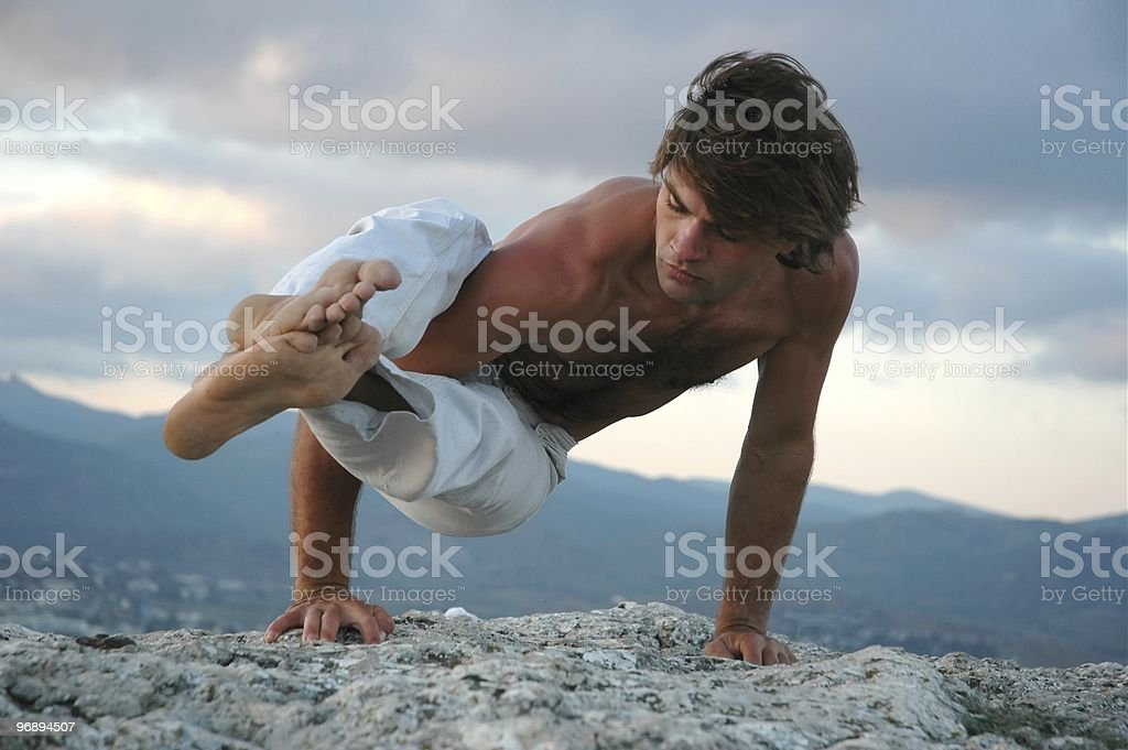 Hatha-yoga: ashtavakrasana #2 royalty-free stock photo