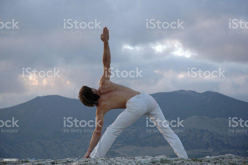 Hatha-yoga: utthita trikonasana. royalty-free stock photo
