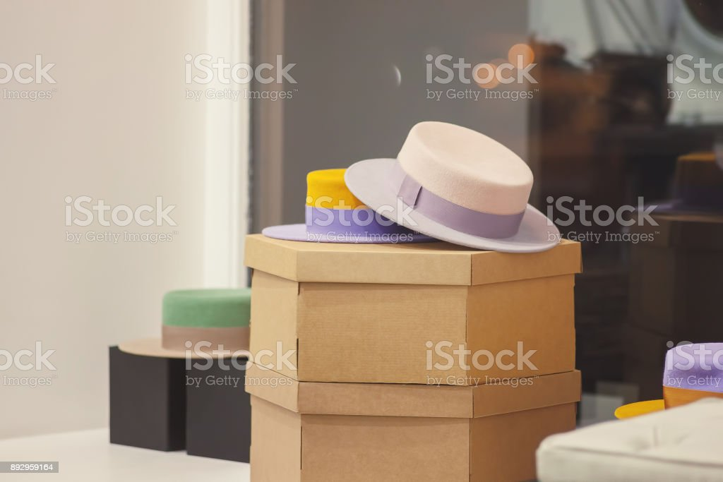 Hats on sale in accessories store. Clothing shop-window stock photo
