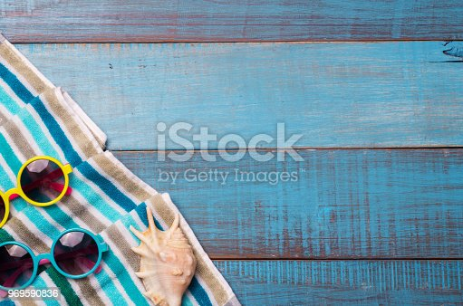 674650538istockphoto Hats, sunglasses, beach shoes, towels on the board 969590836